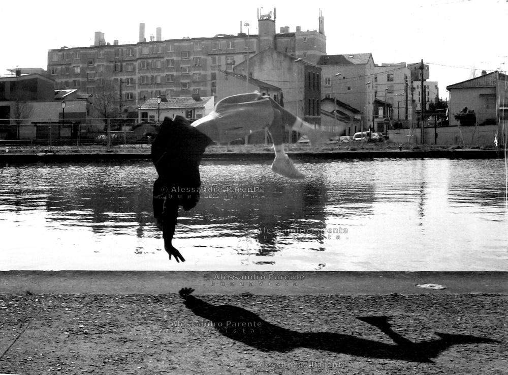 Aubervilliers,Seine Saint Denis. An artist from the Cirque du Soleil is practicing along the canal.