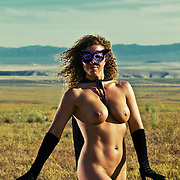 Nude woman wearing a mask and cape in the desert. Super. MR