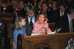 TIM TAYLOR with his daughters ELOISE and ESTELLA at a Christmas Carol service in aid of Breast Cancer Haven held at St.Paul's Knighsbridge, Wilton Place, London on 8th December 2009.