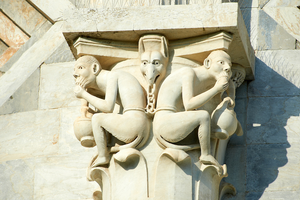 Grotesque Medieval pillar capital sculpture on the exterior of the Duomo Pisa . The Pisa Baptistery of St. John is a Roman Catholic ecclesiastical building in Pisa, Italy. Construction started in 1152 to replace an older baptistery, and when it was completed in 1363, it became the second building, in chronological order, in the Piazza dei Miracoli, near the Duomo di Pisa . The largest baptistery in Italy, it is 54.86 m high, with a diameter of 34.13 m. The Pisa Baptistery is an example of the transition from the Romanesque style to the Gothic style: the lower section is in the Romanesque style, with rounded arches, while the upper sections are in the Gothic style, with pointed arches. The Baptistery is constructed of marble, as is common in Italian architecture.