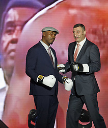 October 1, 2018 - Kiev, Ukraine - Former Boxing Champion LENNOX LEWIS (L) and former heavyweight boxing champion and current Mayor of Kiev VITALI KLITSCHKO (R) are arguing as they are watching on the screen their fight that was in Los Angeles 21 June 2003, during the opening of the 56th World Boxing Convention in Kiev, Ukraine, on 1 October 2018. The WBC 56th congress in which take part boxing legends Evander Holyfield,Lennox Lewis, Eric Morales and about 700 participants from 160 countries runs in Kiev from from September 30 to October 5. (Credit Image: © Serg Glovny/ZUMA Wire)