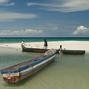 Papuan fishermen preparing their logboats for fishing.