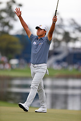 March 16, 2019 - Ponte Vedra Beach, FL, U.S. - PONTE VEDRA BEACH, FL - MARCH 16: Si Woo Kim of Korea reacts after sinking a putt on the 18th hole during the third round of THE PLAYERS Championship on March 16, 2019 on the Stadium Course at TPC Sawgrass in Ponte Vedra Beach, Fl. (Photo by David Rosenblum/Icon Sportswire) (Credit Image: © David Rosenblum/Icon SMI via ZUMA Press)