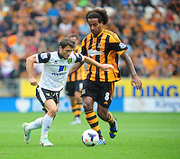 Norwich City's Wesley Hoolahan vies for possession with Hull City's Tom Huddlestone<br /> <br />  (Photo by Chris Vaughan/CameraSport) <br /> <br /> Football - Barclays Premiership - Hull City v Norwich City - Saturday 24th August 2013 - Kingston Communications Stadium - Hull<br /> <br /> © CameraSport - 43 Linden Ave. Countesthorpe. Leicester. England. LE8 5PG - Tel: +44 (0) 116 277 4147 - admin@camerasport.com - www.camerasport.com