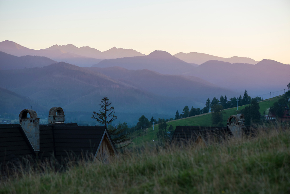 The sun sets in the mountains of Zakopane, in southern Poland