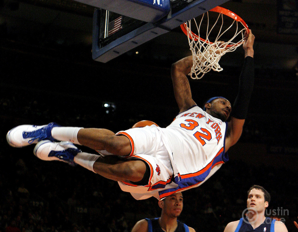 The Knicks' Renaldo Balkman swings from the basket after dunking the ball during the first half of the game between the Dallas Mavericks and the New York Knicks at Madison Square Garden in New York, New York on Tuesday 20 March 2007.
