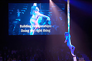 Employees watch motivational circus acrobats at their corporate rally day, held for 3,000 UK staff at Excel