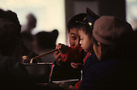child eating with chopsticks in China
