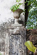 An architectural detail of a plant pot in an old roca, partly abandoned on the island of Principe. Sao Tome and Principe. Sao Tome and Principe, are two islands of volcanic origin lying off the coast of Africa. Settled by Portuguese convicts in the late 1400s and later a centre for slaving, their independence movement culminated in a peaceful transition to self government from Portugal in 1975.