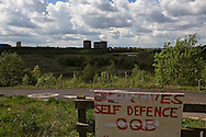 'Untitled, 2014' from the project 'The Fall and Rise of Ravenscraig' by photographer Colin McPherson.<br /> <br /> The photograph shows a a sign advertising self-defence classes nailed to a fence on the site of the former steelworks at Ravenscraig.<br /> <br /> This project, photographed in 2014, looks at the topography of the post-industrial landscape at Ravenscraig, the site until its closure in 1992 of the largest hot strip steel mill in western Europe. In its current state, Ravenscraig is one of the largest derelict sites in Europe measuring over 1,125 acres (4.55 km2) in size, an area equivalent to 700 football pitches or twice the size of Monaco. It is currently being developed with a mix of housing, retail and the home of South Lanarkshire College and the Ravenscraig Regional Sports Facility.