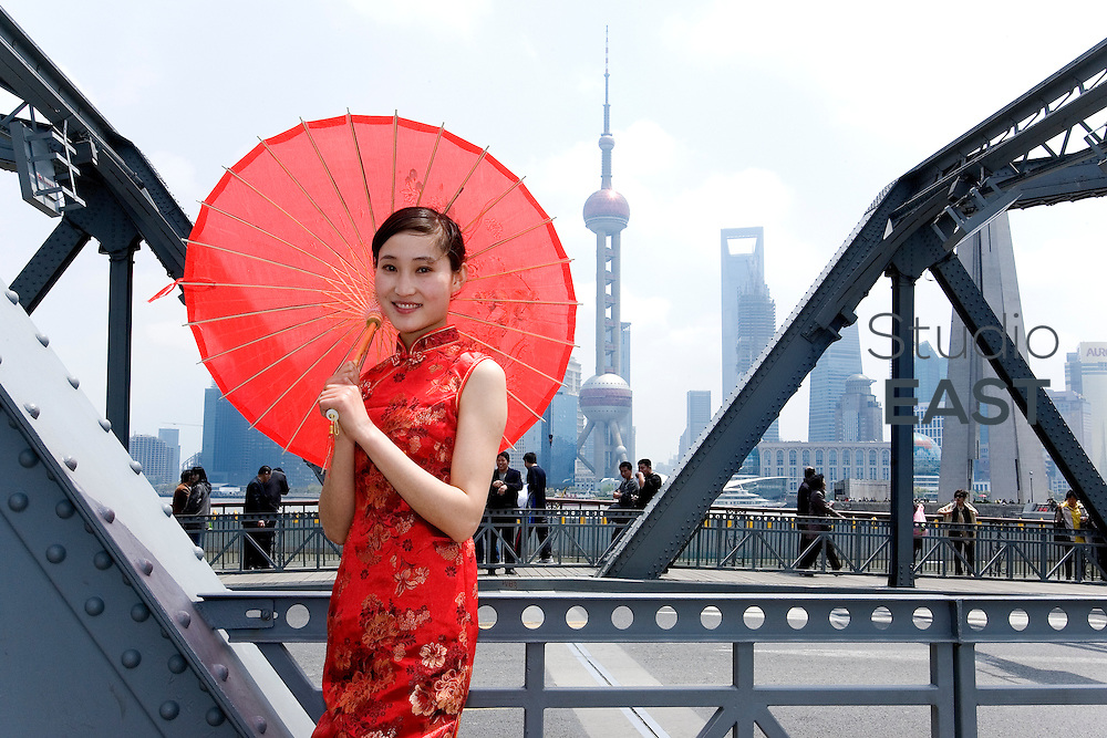 SHANGHAI, CHINA - April 18: CHEN Nana, a hostess for GL events, poses for a photograph on the Waibaidu bridge on April 18, 2010 in Shanghai, China. Chen Nana is 22-year-old and comes from Anhui province in China. (Photo by Lucas Schifres/Getty Images)