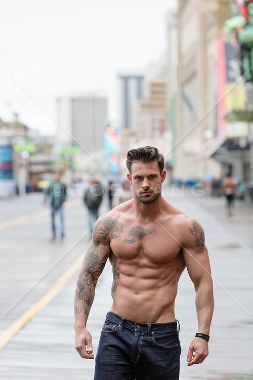 shirtless hunk walking on the boardwalk of Atlantic City, NJ