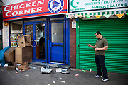 Cash register stolen and opened amongst looted and smashed up shop fronts along London Road in Croydon. The day after rioting took place in Croydon in South London. Riots flared for a third night in a row, resulting in burnt out buildings, looted shops and general smashed up devastation.