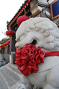China, Beijing, decorated Statue of a lion The Imperial Palace in the Forbidden City