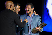 """LAS VEGAS, NV - JULY 10:  Antonio Rodrigo """"Minotauro"""" Nogueira gets a hug from his brother Antonio Rogerio Nogueira and Anderson Silva as he is inducted into the UFC Hall of Fame at the Las Vegas Convention Center on July 10, 2016 in Las Vegas, Nevada. (Photo by Cooper Neill/Zuffa LLC/Zuffa LLC via Getty Images) *** Local Caption *** Antonio Rodrigo """"Minotauro"""" Nogueira; Antonio Rogerio Nogueira; Anderson Silva"""