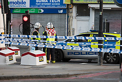 """Finsbury Park, London, June 19th 2017. A major police and emergency services operation with firearms officers in attendance is underway near Finsbury Park Mosque following reports of Several people being injured after a van struck a crowd of pedestrians near a north London mosque in what police have called a """"major incident"""". PICTURED: Firefighters and ambulances along withy the police are at the scene."""