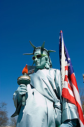 New York City, New York: Street entertainer as Statue of Liberty, in Battery Park.  .Photo #: ny211-14616  .Photo copyright Lee Foster, www.fostertravel.com, lee@fostertravel.com, 510-549-2202.