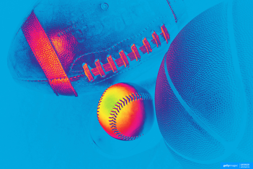 An Artistic studio shot of a Baseball, a Basketball and an American Football. 20th October 2012. Photo Tim Clayton