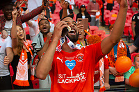 Blackpool's CJ Hamilton celebrates after the match<br /> <br /> Photographer Andrew Vaughan/CameraSport<br /> <br /> The EFL Sky Bet League One Play-Off Final - Blackpool v Lincoln City - Sunday 30th May 2021 - Wembley Stadium - London<br /> <br /> World Copyright © 2021 CameraSport. All rights reserved. 43 Linden Ave. Countesthorpe. Leicester. England. LE8 5PG - Tel: +44 (0) 116 277 4147 - admin@camerasport.com - www.camerasport.com