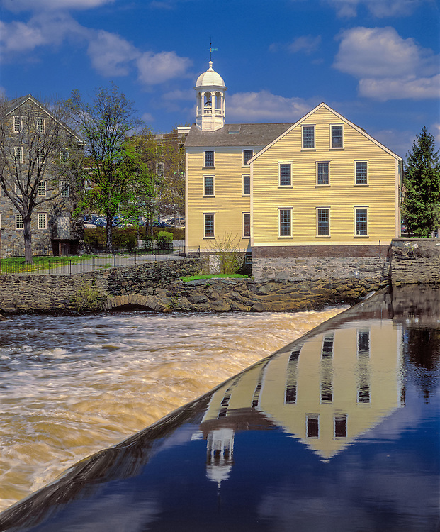 Birthplace of American Industrial Revolution, Slater Mill with reflections in Blackstone River, Pawtucket, RI