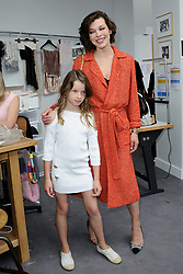 File photo of Milla Jovovich and her daughter attending the Chanel Haute Couture Fall - Winter 2016/2017 show as part of Paris Fashion Week on July 05, 2016 in Paris, France. Actress Milla Jovovich has revealed she is pregnant again for a third time, after suffering a loss during her last pregnancy 'due to her age'. Photo by Aurore Marechal/ABACAPRESS.COM.