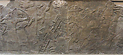 an attack on an enemy town. Archers and siege engines shown. Assyrian relief 865-860 BC from Nimrud