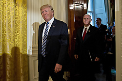 January 22, 2017 - Washington, District of Columbia, U.S.- United States President DONALD TRUMP, left, and U.S. Vice President MIKE PENCE arrive to a swearing in ceremony of White House senior staff in the East Room of the White House. Trump earlier today mocked protesters who gathered for large demonstrations across the U.S. and the world on Saturday to signal discontent with his leadership, but later offered a more conciliatory tone, saying he recognized such marches as a ''hallmark of our democracy.''  (Credit Image: © Andrew Harrer/Pool/CNP via ZUMA Wire)