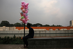 October 3, 2018 - Dhaka, Bangladesh - A cotton candy seller waits for customers at Suhrawardy Udyan also known as the Ramna Race Course ground is a national memorial for the country. (Credit Image: © MD Mehedi Hasan/ZUMA Wire)