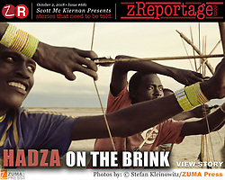 zReportage.com Story of the Week # 681 -  Hadza On The Brink - Launched October 4, 2018 - Full multimedia experience: audio, stills, text and or video: Go to zReportage.com to see more - The Hadza tribe of Tanzania are one of the last remaining societies in Africa, that survive purely from hunting and gathering. Very little has changed in the way the Hadza live their lives. But it has become increasingly harder for them to pursue the iconic Hadza way of life. Today of roughly 1,300 Hadza living in the dry hills here between salty Lake Eyasi and the Rift Valley highlands, only about 100 to 300 still hunt and gather most of their food. The Hadza's homeland lies on the edge of the Serengeti plains, in the shadow of Ngorongoro Crater. It is also close to Olduvai Gorge, one of the most important prehistoric sites in the world, where homo habilis, one of the earliest members of the genus Homo was discovered to have lived 1.9 million years ago. The Hadza have probably lived in the Yaeda Chini area for millennia. Genetically like the Bushmen of southern Africa they are one of the 'oldest' lineages of humankind. They speak a click language that is unrelated to any other language on earth. Their way of life is being encroached on by pastoralists whose cattle drink their water and graze on their grasslands, with farmers clearing woodland to grow crops, and climate change that dries up rivers and stunts grass. Over the past 50 years, the tribe has lost 90% of its land. Either the Hadza will find a way to secure their land-rights to have access to unpolluted water springs and wild animals, or the Hadzabe lifestyle will disappear, with the majority of them ending up as poor and uneducated individuals within a Westernized society that is completely foreign to them.  (Credit Image: ? Stefan Kleinowitz/ZUMA Wire)