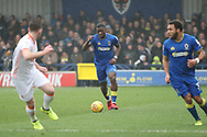 AFC Wimbledon defender Deji Oshilaja (4) starting an attack during the EFL Sky Bet League 1 match between AFC Wimbledon and Blackpool at the Cherry Red Records Stadium, Kingston, England on 20 January 2018. Photo by Matthew Redman.