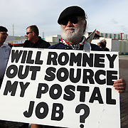 A retired U.S. Postal worker pickets prior to a parade during the Republican National Convention in Tampa, Fla. on Wednesday, August 29, 2012. (AP Photo/Alex Menendez)