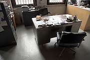 old style chairs and desk in office corner of wood shop