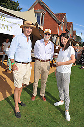 Left to right, ANDREW LANGTON, VISCOUNT COWDRAY and CLEMENTINE WILMOT at a cricket match to in aid of CARE - Corfu Animal Rescue Establishment held at Hawkley Cricket Club, Hawkley, Hampshire on 8th September 2012.