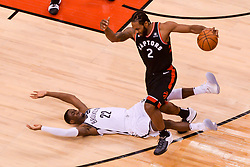 February 11, 2019 - Toronto, Ontario, Canada - Kawhi Leonard #2 of the Toronto Raptors steps over Caris LeVert #22 of the Brooklyn Nets during the Toronto Raptors vs Brooklyn Nets NBA regular season game at Scotiabank Arena on February 11, 2019, in Toronto, Canada (Toronto Raptors win 127-125) (Credit Image: © Anatoliy Cherkasov/NurPhoto via ZUMA Press)
