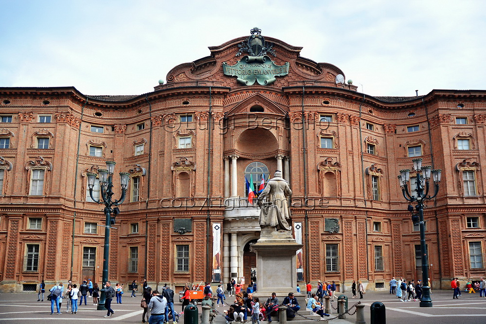 Turin, Piedmont/Italy -04/20/2019- Turin the curved brick façade of Palazzo Carignano, home to the first parliament of unified kingdom of Italy.