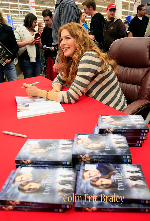 Twilight star Rachelle Lefevre, who plays the character Victoria, signs autographs for fans at the Walmart store in Riverton, Utah during the midnight DVD movie release event March 21, 2009. (AP Photo/Colin Braley)