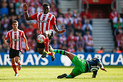 Southampton's Victor Wanyama jumps over Swansea City's Andre Ayew tackle - Mandatory by-line: Jason Brown/JMP - 07966 386802 - 26/09/2015 - FOOTBALL - Southampton, St Mary's Stadium - Southampton v Swansea City - Barclays Premier League