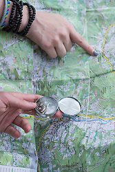 Hikers check route on map with Compass, Bavaria, Germany