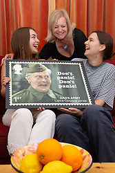 L-R Granddaughter Alice, Daughter Jessica and granddaughter Lydia admire a stamp design featuring Dad's Army's Clive Dunn. London, June 04 2018.