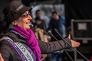 Helen Pankurst speaks - #March4Women 2018, a march and rally in London to celebrate International Women's Day and 100 years since the first women in the UK gained the right to vote.  Organised by Care International the march stated at Old Palace Yard and ended in a rally in Trafalgar Square.