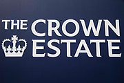Crown Estate signage is pictured on a hoarding panel around a construction site on 30th July 2021 in London, United Kingdom. The Crown Estate is an independent commercial business created by an Act of Parliament; its portfolio includes buildings, forestry, agricultural land, common land, shoreline and seabed in the UK.