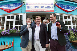 © Licensed to London News Pictures. 13/07/2018. London, UK.  David Campbell Bannerman MEP (centre) at the Donald Trump special relationship evening and welcome party held at  the Trump Arms Pub (formerly known as Jameson Pub) in Hammersmith, west London. The pub has been decked out with American flags and banners celebrating Donald Trump's arrival in the UK..  Photo credit: Vickie Flores/LNP