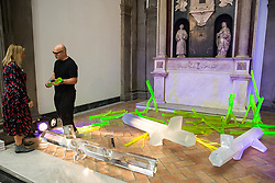 London, UK. 13 September, 2019. Czech designer Rony Plesl discusses his Sacred Geometry installation at the Victoria & Albert museum at the launch of the London Design Festival. A glass installation inspired by Sacred Geometry, a universal language which organises all visible and invisible reality according to basic geometrical principles, it features three identical hexagonal glass tree trunks contrasted by a glowing forest of uranium glass which radiates green fluorescent light. It employs a groundbreaking melted-glass technology developed by Czech company Bolety being given its international premiere at the London Design Festival.