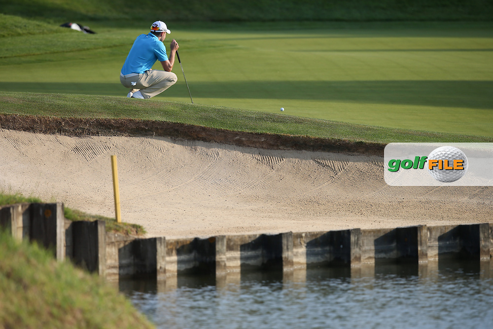 Maximilian Kieffer (GER) putting for birdie on the 16th during Round One of the 2015 Alstom Open de France, played at Le Golf National, Saint-Quentin-En-Yvelines, Paris, France. /03/07/2015/. Picture: Golffile | David Lloyd<br /> <br /> All photos usage must carry mandatory copyright credit (© Golffile | David Lloyd)