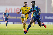Anthony Stewart of Wycombe Wanderers under pressure from Jamie Mackie of Oxford United during the EFL Sky Bet League 1 match between Oxford United and Wycombe Wanderers at the Kassam Stadium, Oxford, England on 30 March 2019.