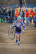 SHOT 1/12/14 4:37:32 PM - Jonathan Page (#1) of Northfield, N.H.  shoulders his bike on the 5280' Run Up section in the Men's Elite race at the 2014 USA Cycling Cyclo-Cross National Championships at Valmont Bike Park in Boulder, Co. Page finished sixth in the race. (Photo by Marc Piscotty / © 2014)