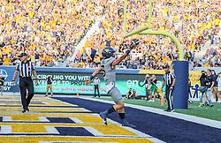 Sep 11, 2021; Morgantown, West Virginia, USA; West Virginia Mountaineers quarterback Garrett Greene (6) runs for a touchdown during the second quarter against the Long Island Sharks at Mountaineer Field at Milan Puskar Stadium. Mandatory Credit: Ben Queen-USA TODAY Sports