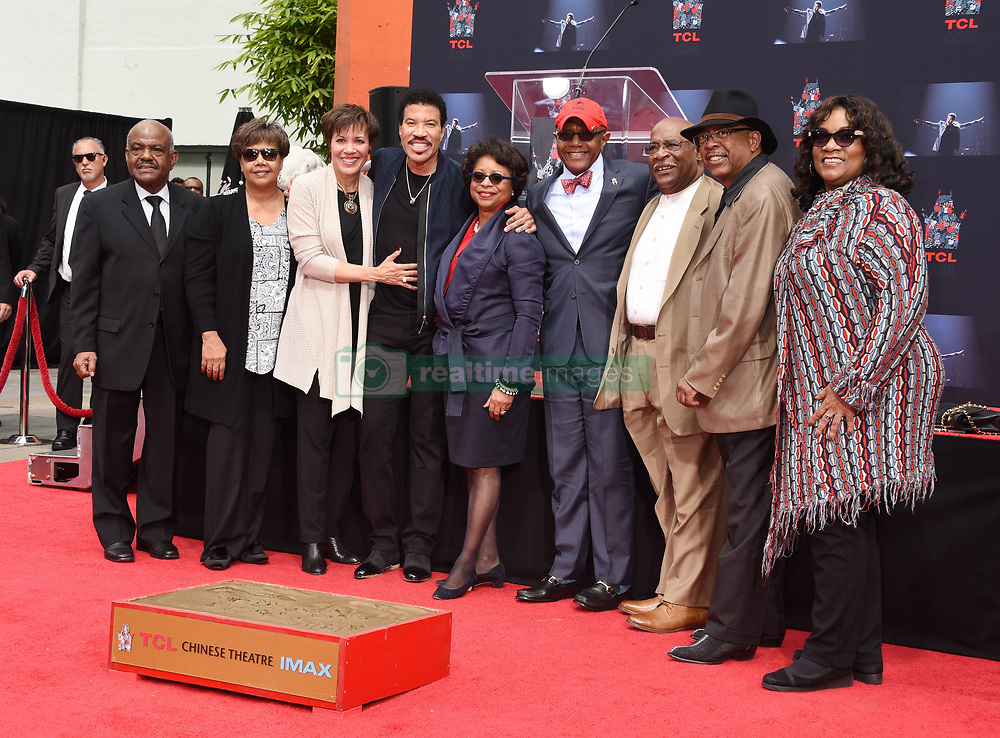 Lionel Richie Handprints and Footprints at the Lionel Richie Hand and Footprints Ceremony at the TCL Chinese Theatre on March 7, 2018 in Hollywood, Ca. © Janet Gough / AFF-USA.COM. 07 Mar 2018 Pictured: Lionel Richie and school friends. Photo credit: MEGA TheMegaAgency.com +1 888 505 6342