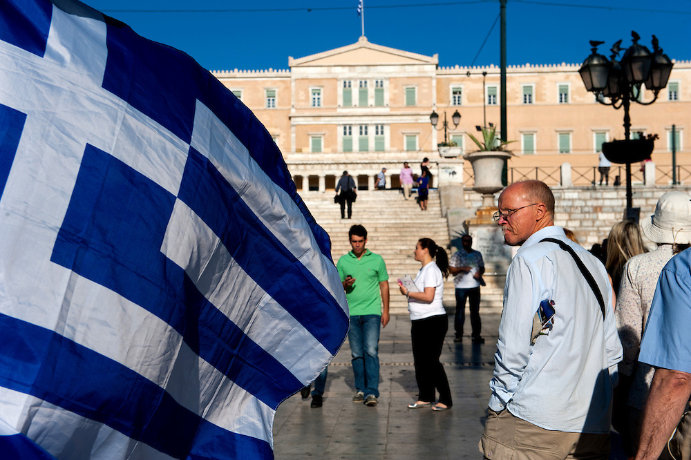 Athenians walking in front of the Greek parliament, Syntagma Sq,  Athens, Greece