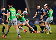 Harlequins Mat Luamanu offloads as he's tackled by Sale Sharks prop WillGriff John tackle  during a Gallagher Premiership match won by Sale Sharks 27-17 at the AJ Bell Stadium, Eccles, Greater Manchester, United Kingdom, Friday, April 5, 2019. (Steve Flynn/Image of Sport)